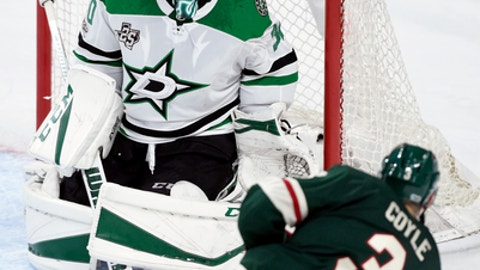 Minnesota Wild center Charlie Coyle (3) scores against Dallas Stars goalie Ben Bishop (30) during the second period of an NHL preseason hockey game Saturday, Sept. 30, 2017, in St. Paul, Minn. (AP Photo/Hannah Foslien)