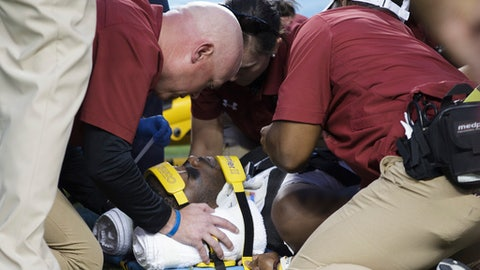 South Carolina wide receiver Terry Googer (6) is looked over by medical personal after being injured during the first quarter of an NCAA college football game against Texas A&M, Saturday, Sept. 30, 2017, in College Station, Texas. (AP Photo/Sam Craft)