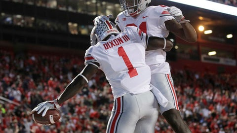 Ohio State wide receiver Johnnie Dixon (1) celebrates a touchdown with teammate Parris Campbell during the first half of an NCAA college football game against Rutgers, Saturday, Sept. 30, 2017, in Piscataway, N.J. (AP Photo/Mel Evans)