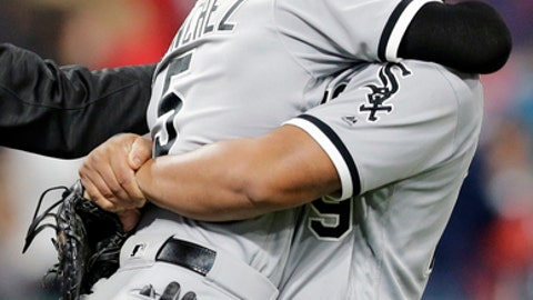 Chicago White Sox's Jose Abreu, right, lifts up and hugs Yolmer Sanchez after theydefeated the Cleveland Indians in a baseball game, Saturday, Sept. 30, 2017, in Cleveland. (AP Photo/Tony Dejak)