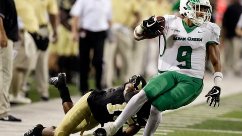 North Texas wide receiver Jaylen Guyton (9) is brought down by a Southern Mississippi defensive back Curtis Mikell (19) following a third quarter pass reception for a first down during their NCAA college football game in Hattiesburg, Miss., Saturday, Sept. 30, 2017. North Texas won 43-28. (AP Photo/Rogelio V. Solis)