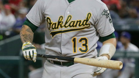 Oakland Athletics Bruce Maxwell heads to the dugout after striking out during the eighth inning of a baseball game against the Texas Rangers in Arlington, Texas, Saturday, Sept. 30, 2017. The Rangers won 8-4. (AP Photo/LM Otero)