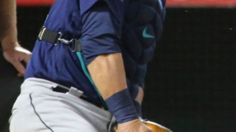 Seattle Mariners catcher Carlos Ruiz takes a bounced pitch in the face from pitcher Dan Alatvilla against the Los Angeles Angels in the sixth inning of a baseball game in Anaheim, Calif., Saturday, Sept. 30, 2017. (AP Photo/Reed Saxon)
