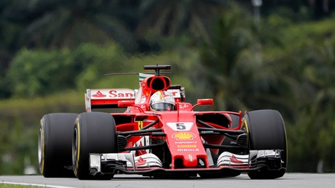 Hamilton turns tables on Vettel as he grabs pole for Malaysia GP