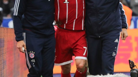 Bayern's  Franck Ribery center is helped after he got injured during the German Bundesliga soccer match between Hertha BSC Berlin and FC Bayern Munich in Berlin, Sunday, Oct. 1, 2017.   (Michael Kappeler/dpa via AP)