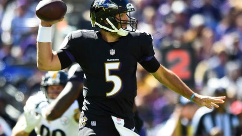 Baltimore Ravens quarterback Joe Flacco (5) passes the ball during the first half of an NFL football game against the Pittsburgh Steelers in Baltimore, Sunday, Oct. 1, 2017. (AP Photo/Gail Burton)
