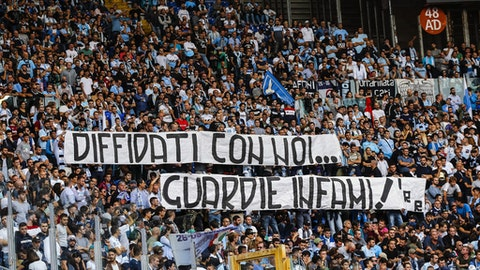 """Lazio fans display a banner reading in Italian """"Banned fans with us, vile cops"""" during the Serie A soccer match between Sassuolo and Lazio at the Olympic stadium in Rome, Sunday, Oct. 1, 2017.  Lazio's problem in dealing with racism among its fans resurfaced during the Roman club's 6-1 win over visiting Sassuolo in Serie A on Sunday. After derogatory chants were directed at Sassuolo players Claud Adjapong and Alfred Duncan, the stadium announcer warned that the match could be suspended if the chants continued. (Angelo Carconi/ANSA via AP)"""