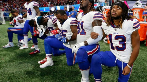 Buffalo Bills players take a knee during the national anthem before the first half of an NFL football game between the Atlanta Falcons and the Buffalo Bills, Sunday, Oct. 1, 2017, in Atlanta. (AP Photo/John Bazemore)