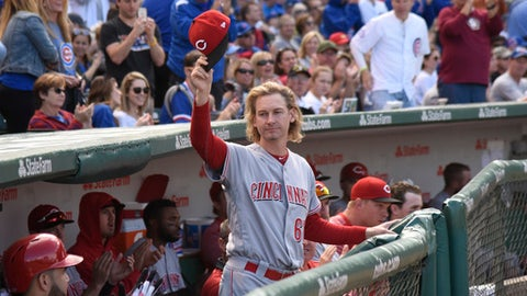 Cincinnati Reds pitcher Bronson Arroyo (61) tips his cap as he's retiring from playing baseball and was honored during the fourth inning of a baseball game between the Chicago Cubs and the Cincinnati Reds, Sunday, Oct. 1, 2017, in Chicago. (AP Photo/David Banks)