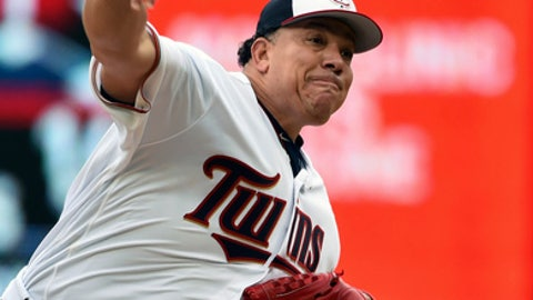 Minnesota Twins pitcher Bartolo Colon pitches to the Detroit Tigers in the first inning of a baseball game, Sunday October 1, 2017, in Minneapolis. (AP Photo/John Autey)