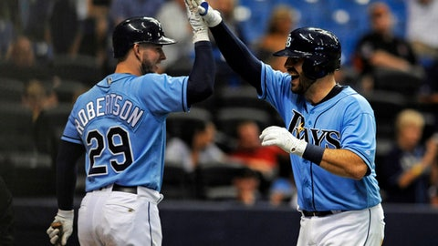 Tampa Bay Rays' Daniel Robertson, left, congratulates Curt Casali after his solo home run off Baltimore Orioles starter Kevin Gausman during the fifth inning of a baseball game Sunday, Oct. 1, 2017, in St. Petersburg, Fla. (AP Photo/Steve Nesius)