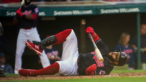 Cleveland Indians' Carlos Santana falls after a foul tip off his leg during the sixth inning of a baseball game against the Chicago White Sox in Cleveland, Sunday, Oct. 1, 2017. (AP Photo/Phil Long)