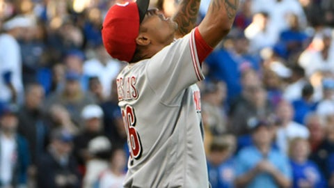 Cincinnati Reds relief pitcher Raisel Iglesias reacts after getting the final out against the Chicago Cubs during the ninth inning of a baseball game, Sunday, Oct. 1, 2017, in Chicago. (AP Photo/David Banks)