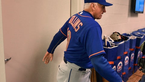 New York Mets manager Terry Collins walks from his office after resigning following a game against the Philadelphia Phillies, Sunday, Oct. 1, 2017, in Philadelphia. New York Mets manager Terry Collins resigned Sunday and will take a position in the team's front office. Collins announced the move after the Mets lost to Philadelphia 11-0 to finish the season.  (AP Photo/Derik Hamilton)