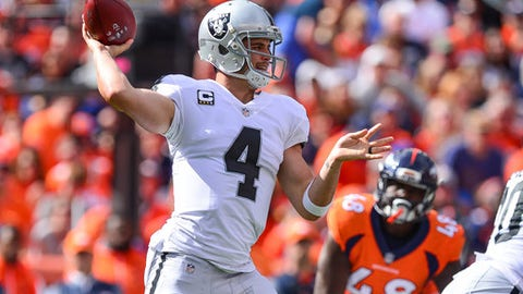DENVER, CO - OCTOBER 1:  Quarterback Derek Carr #4 of the Oakland Raiders throws against the Denver Broncos in the first quarter at Sports Authority Field at Mile High on October 1, 2017 in Denver, Colorado. (Photo by Dustin Bradford/Getty Images)