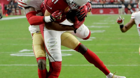 Arizona Cardinals wide receiver Larry Fitzgerald (11) pulls in the game winning touchdown as San Francisco 49ers cornerback Rashard Robinson (33) defends during overtime of an NFL football game, Sunday, Oct. 1, 2017, in Glendale, Ariz. The Cardinals won 18-15. (AP Photo/Rick Scuteri)