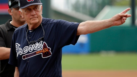 FILE - In this March 13, 2017, file photo, former Major League baseball pitcher and hall of fame player Phil Niekro waves to fans after he was introduced before a spring training baseball game between the Atlanta Braves and the Pittsburgh Pirates in Kissimmee, Fla. The knuckleball has always been a bit of oddball, the butt of jokes, the object of endless curiosity, a talismanic pitch understood by only a few. It could soon be extinct in the big leagues, and that would be quite a shame. (AP Photo/John Raoux, File)