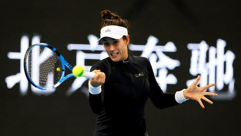 Garbine Muguruza of Spain returns a shot against Barbara Strycova of the Czech Republic during their women's singles match in the China Open tennis tournament at the Diamond Court in Beijing, Monday, Oct. 2, 2017. (AP Photo/Andy Wong)