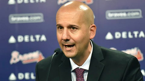 FILe - In this Oct. 1, 2015, file photo, Atlanta Braves general manager John Coppolella speaks during a baseball news conference at Turner Field in Atlanta. Coppolella has resigned from his position, the Braves announced on Monday afternoon, Oct. 2, 2017 (Hyosub Shin/Atlanta Journal-Constitution via AP, File)