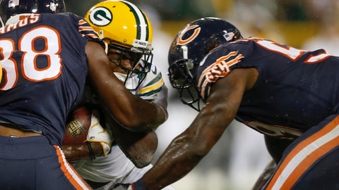 FILE - In this Thursday, Sept. 28, 2017, file photo, Green Bay Packers' Davante Adams is hit by Chicago Bears' Adrian Amos and Danny Trevathan during the second half of an NFL football game, in Green Bay, Wis. Adams was lucky he wasn't more seriously injured on Trevathan's illegal hit on the Green Bay receiver. And Chicago's thumping linebacker, who was flagged and suspended for two games, is fortunate he wasn't ejected. (AP Photo/Matt Ludtke, File)