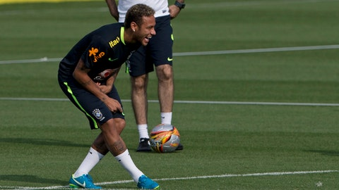 Brazil's Neymar laughs during a practice session with the national soccer team in Teresopolis, Brazil, Monday, Oct. 2, 2017. Brazil will face Bolivia in a 2018 World Cup qualifying soccer match in La Paz on Thursday. (AP Photo/Silvia Izquierdo)