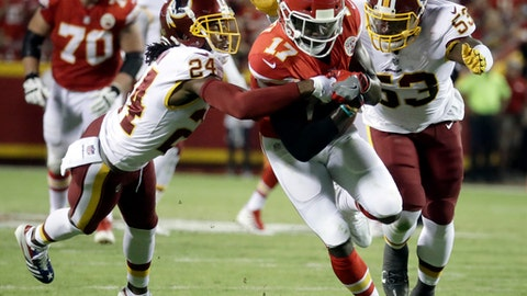 Washington Redskins cornerback Josh Norman (24) and linebacker Zach Brown (53) tackle Kansas City Chiefs wide receiver Chris Conley (17) during the first half of an NFL football game in Kansas City, Mo., Monday, Oct. 2, 2017. Norman was injured on the play. (AP Photo/Charlie Riedel)