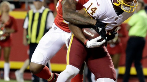 Washington Redskins wide receiver Ryan Grant (14) scores a touchdown against Kansas City Chiefs defensive back Marcus Peters (22) during the second half of an NFL football game in Kansas City, Mo., Monday, Oct. 2, 2017. (AP Photo/Charlie Riedel)