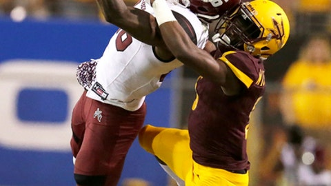 FILE - In this Aug. 31, 2017, file photo, New Mexico State wide receiver Jaleel Scott (16) makes a catch in front of Arizona State defensive back Kobe Williams during the second half of an NCAA college football game in Tempe, Ariz. Scott ranks 13th in the nation in yards receiving per game at 108.6 and has scored five touchdowns. Last week against Arkansas, he had his best game of the season with nine catches for 174 yards and a touchdown. (AP Photo/Rick Scuteri, File)