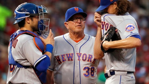 New York Mets starting pitcher Jacob deGrom, right, talks with pitching coach Dan Warthen, center, and catcher Travis d'Arnaud, left, after giving up a solo home run to St. Louis Cardinals' Jedd Gyorko during the fourth inning of a baseball game Friday, July 7, 2017, in St. Louis. (AP Photo/Jeff Roberson)