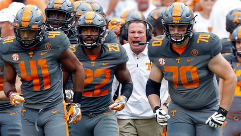 FILE - In this Saturday, Sept. 30, 2017, file photo, Tennessee head coach Butch Jones yells to his players during the first half of a 41-0 loss to Georgia in an NCAA college football game in Knoxville, Tenn. Tennessee is using its off week to try regrouping following a dispiriting three-week stretch that included its worst home defeat since 1905 and put the heat squarely on embattled coach Jones. (AP Photo/Wade Payne, File)