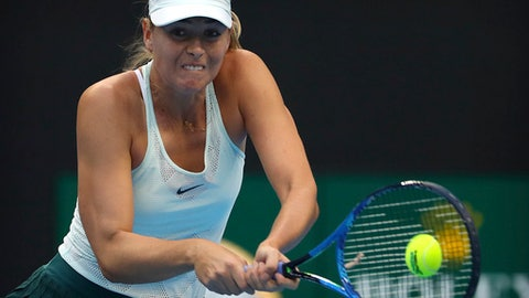 Maria Sharapova of Russia returns a shot against Simona Halep of Romania during their wommen's singles match in the China Open tennis tournament at the Diamond Court in Beijing, Wednesday, Oct. 4, 2017. (AP Photo/Mark Schiefelbein)