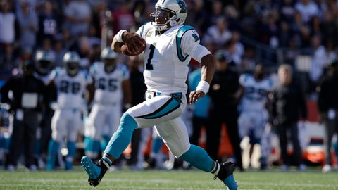 FILE - In this Oct. 1, 2017, file photo, Carolina Panthers quarterback Cam Newton runs during the second half of an NFL football game against the New England Patriots, in Foxborough, Mass. The Panthers were more successful on offense last week with Newton running the football. (AP Photo/Charles Krupa, File)