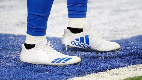 FILE- In this Sunday, Sept. 10, 2017 file photo, Detroit Lions running back Ameer Abdullah wears adidas cleats before an NFL football game against the Arizona Cardinals in Detroit. Multi-million dollar sponsor partnerships between sports equipment companies and U.S. university athletic programs _ like the one between Adidas and the University of Louisville _ are a key weapon in the battle for sales and profits in the world's largest economy. (AP Photo/Paul Sancya, File)
