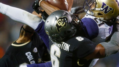 FILE - In this  Saturday, Sept. 23, 2017, file photo, Washington wide receiver Quinten Pounds, back, pulls in a pass for a touchdown in front of Colorado defensive back Evan Worthington in the second half of an NCAA college football game in Boulder, Colo. Worthington is making the most of his second chance on Colorado's roster after being suspended for violating team rules last year. (AP Photo/David Zalubowski, File)