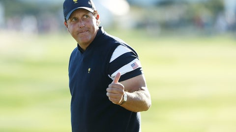 JERSEY CITY, NJ - OCTOBER 01:  Phil Mickelson of the U.S. Team reacts during Sunday singles matches of the Presidents Cup at Liberty National Golf Club on October 1, 2017 in Jersey City, New Jersey.  (Photo by Elsa/Getty Images)