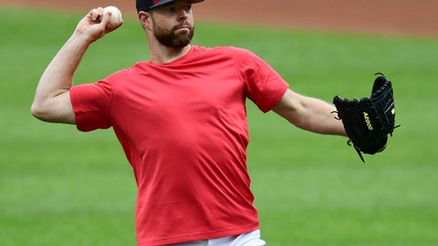 Cleveland Indians starting pitcher Corey Kluber warms up during a team workout, Wednesday, Oct. 4, 2017, in Cleveland. The Indians will play the New York Yankees in Game 1 of the ALDS on Thursday. (AP Photo/David Dermer)