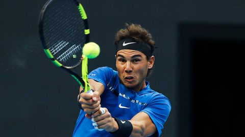 Rafael Nadal of Spain hits a return shot against Karen Khachanov of Russia during their second round of the men's singles match in the China Open tennis tournament at the Diamond Court in Beijing, Thursday, Oct. 5, 2017. (AP Photo/Andy Wong)