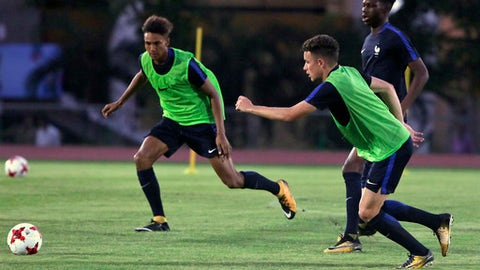 French soccer players practice ahead of their match for the FIFA U-17 World Cup in Gauhati, India, Thursday, Oct. 5, 2017. (AP Photo/ Anupam Nath)