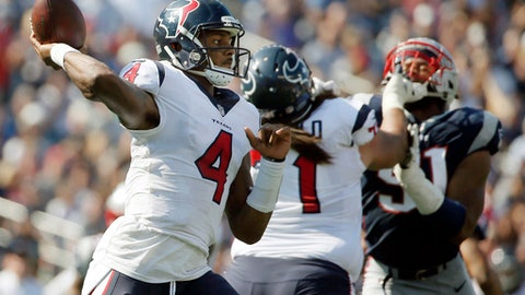 FILE- In this Sept. 24, 2017, file photo, Houston Texans quarterback Deshaun Watson (4) throws a pass against the New England Patriots during the first half of an NFL football game in Foxborough, Mass. Watson is doing things that no rookie quarterback has done in the NFL since the likes of Fran Tarkenton in the 1960s. Most everyone is wowed by what he is doing for the Texans. Everyone, that is, except Watson himself.  (AP Photo/Michael Dwyer, File)