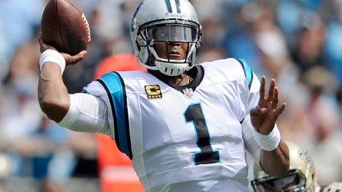 FILE - In this Sunday, Sept. 24, 2017 file photo, Carolina Panthers' Cam Newton (1) looks to pass against the New Orleans Saints in the first half of an NFL football game in Charlotte, N.C. A woman accused of stalking Panthers quarterback Cam Newton was asked to leave the team's practice facility earlier this week. The incident occurred on Wednesday, Oct. 4, 2017 according to a Charlotte Mecklenburg police report.(AP Photo/Mike McCarn, File)