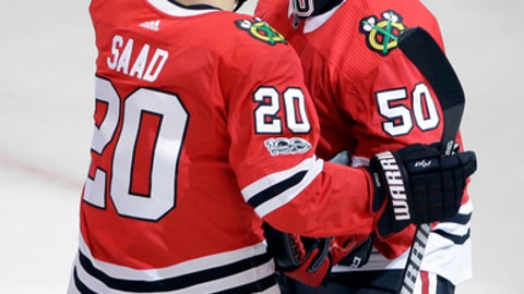 Chicago Blackhawks goalie Corey Crawford, right, celebrates with Brandon Saad after the Blackhawks defeated the Pittsburgh Penguins 10-1 in an NHL hockey game Thursday, Oct. 5, 2017, in Chicago. (AP Photo/Nam Y. Huh)