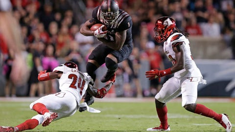 Louisville's Zykiesis Cannon (24) and Khane Pass try to tackle North Carolina State's Jaylen Samuels (1) during the second half of an NCAA college football game in Raleigh, N.C., Thursday, Oct. 5, 2017. North Carolina State won 39-25. (AP Photo/Gerry Broome)