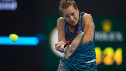 Barbora Strycova of the Czech Republic returns a shot from Petra Kvitova of the Czech Republic during a women's singles quarterfinal match in the China Open tennis tournament at the Diamond Court in Beijing, China, Friday, Oct. 6, 2017. (AP Photo/Ng Han Guan)
