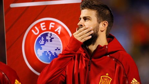 Spain's Gerard Pique stands with his teammates before the World Cup Group G qualifying soccer match between Spain and Albania at the Rico Perez stadium in Alicante, Spain, Friday, Oct. 6, 2017. Spain coach Julen Lopetegui has defended Gerard Pique from critics who question his loyalty to the national team because of his support for a disputed referendum on Catalan independence. (AP Photo/Alberto Saiz)
