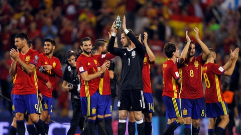 Spain players celebrate at the end of the World Cup Group G qualifying soccer match between Spain and Albania at the Rico Perez stadium in Alicante, Spain, Friday, Oct. 6, 2017. Spain won 3-0 and qualified for the 2018 tournament finals. (AP Photo/Alberto Saiz)