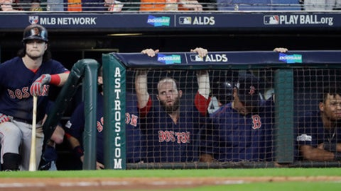 Boston Red Sox's Andrew Benintendi, left, waits to bat during the ninth inning in Game 2 of baseball's American League Division Series, Friday, Oct. 6, 2017, in Houston. Houston won 8-2. (AP Photo/David J. Phillip)