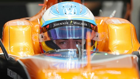 McLaren driver Fernando Alonso of Spain waits in his car during the third practice session for the Japanese Formula One Grand Prix at Suzuka Circuit in Suzuka, central Japan, Saturday, Oct. 7, 2017. (AP Photo/Eugene Hoshiko)