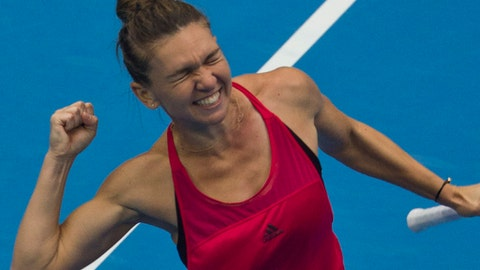 Simon Halep of Romania celebrates defeating Jelena Ostapenko of Lativa to secure her world number one ranking after the women's singles semi-final match in the China Open tennis tournament at the Diamond Court in Beijing, China, Saturday, Oct. 7, 2017. (AP Photo/Ng Han Guan)