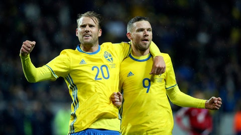 Sweden's Marcus Berg, right, celebrates scoring with teammate Ola Toivonen during the World Cup 2018 group A qualifying match between Sweden and Luxembourg at Friends Arena in Solna, Stockholm, Saturday Oct. 7, 2017. (Soren Andersson/TT via AP)