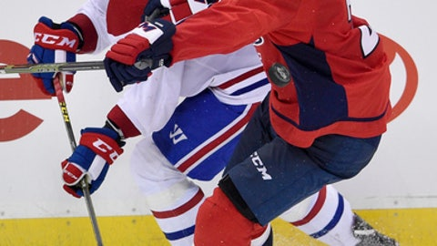 Montreal Canadiens left wing Charles Hudon (54) and Washington Capitals defenseman Matt Niskanen (2) battle for the puck during the third period of a NHL hockey game, Saturday, Oct. 7, 2017, in Washington. The Capitals won 6-1. (AP Photo/Nick Wass)